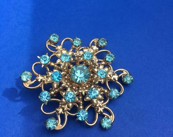 Stunning icy blue vintage starburst scrolly brooch pin