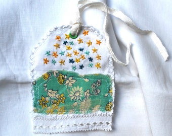 Green and yellow embroidered linen textile gift tag