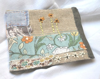 hand-stitched needlecase with vintage and antique textiles and embroidery