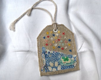 Linen gift tag with feedsack and embroidery, paper panel to write on