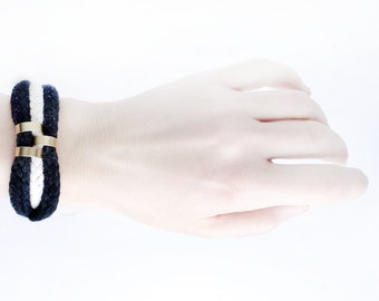 Black and white cord bracelet with gold beads