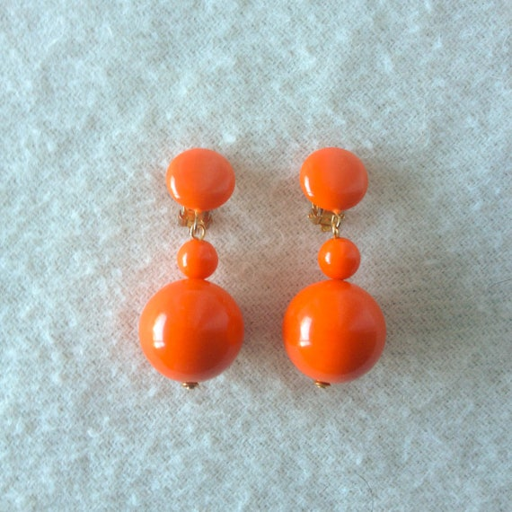 Vintage Lucite Dangle Sphere Orange Clip on Earrin