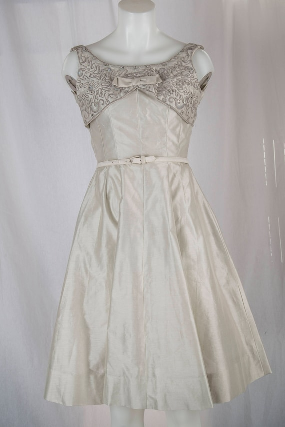 Natlynn, 1960s grey, sequined party dress. Tailore