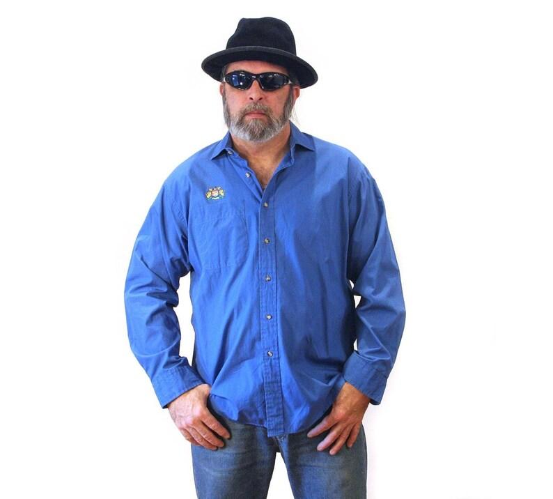 0faffe53e36a1f 80s Izod Men's Shirt XL Blue Vintage Embroidered Crest | Etsy