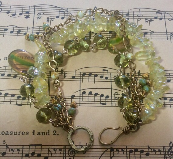 Multistrand brass and glass bracelet with matching vintage necklace.