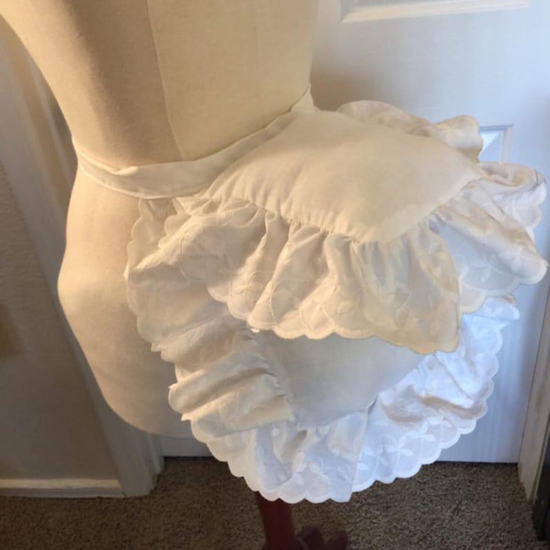 Victorian Lingerie History – Corset, Chemise, Petticoats 1870s-1880s Late Victorian Bustle Pad $45.00 AT vintagedancer.com