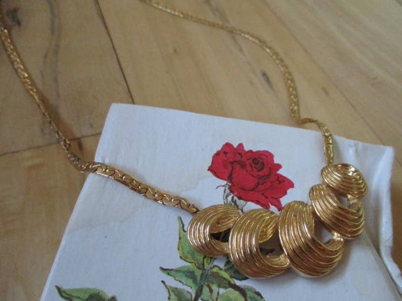 Vintage Goldtone Necklace Unmarked beautiful shiny Very good vintage condition China Galore  Goldtone flat chain