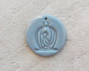 Gray porcelain enamel medal.