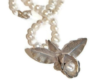 Extraordinary Silver Lily Pendant on Baroque Pearl Necklace