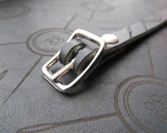 Matte black leather logo wristlet