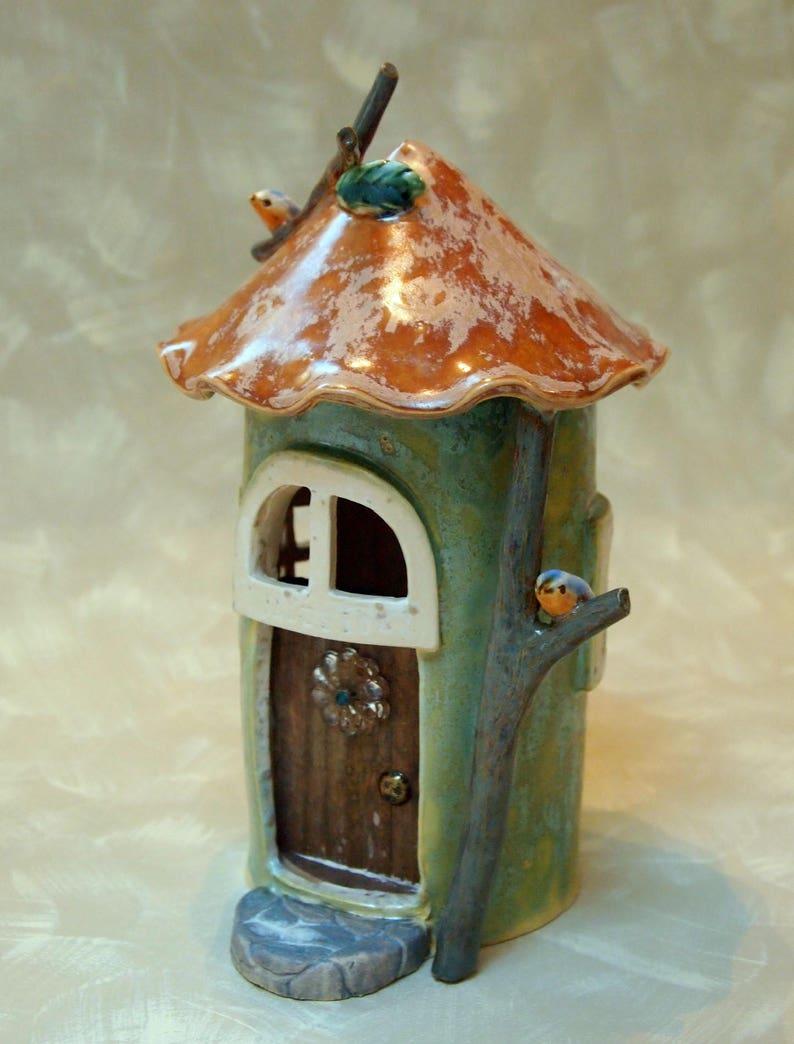 ceramic fairy house with bluebirds