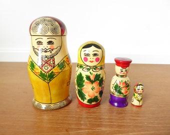 Yellow matroyshka doll family of four