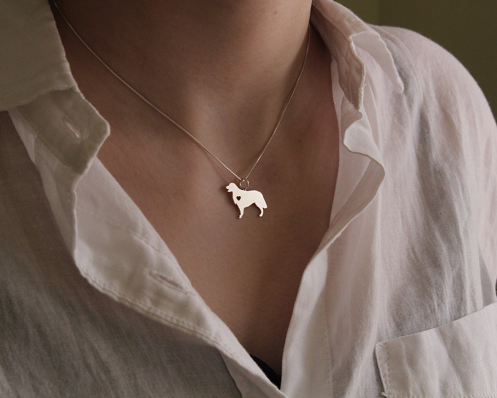 Sterling silver necklace with a Golden Retriever pendant.