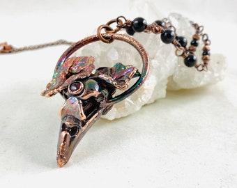 Raven Queen pendant necklace, electroformed, witchy, raven skull, third eye, bird skull, raven queen, crow skull, real flowers, garnet