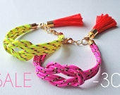 SALE Neon pink knot rope bracelet with tassel charm