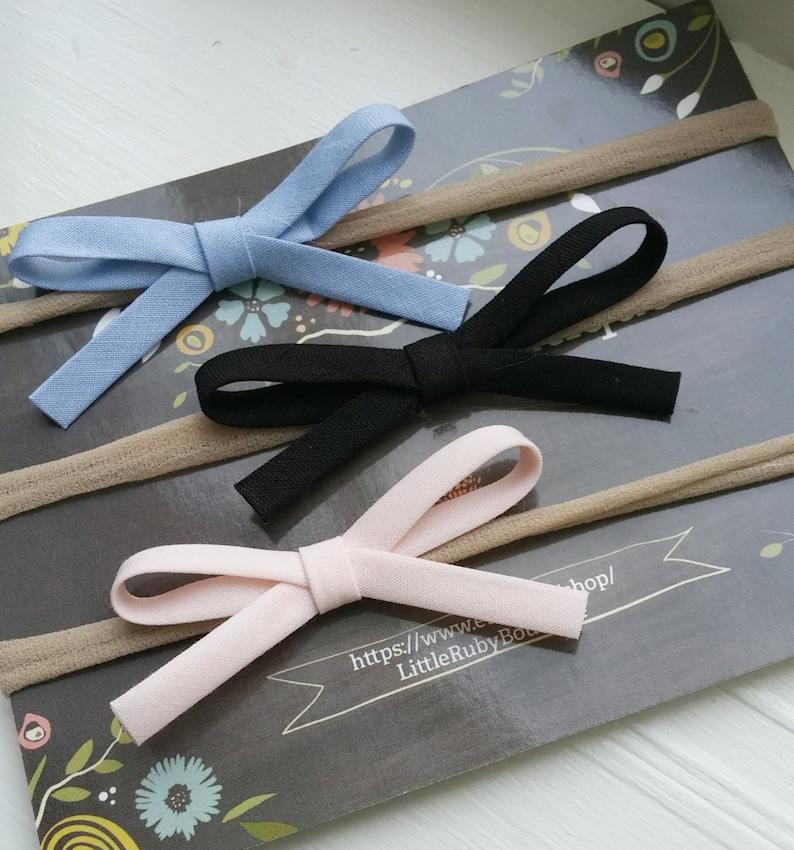 Set of THREE baby bows on nylon headbands