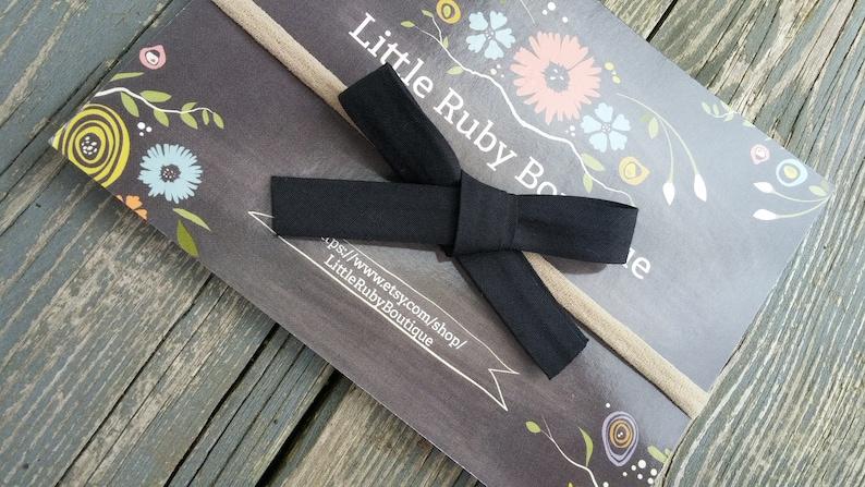 Black bow on nude nylon
