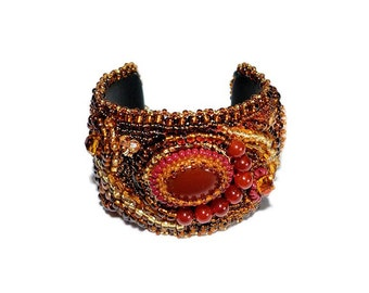 Free shipping USA & Canada. Bead Embroidered Freeform Cuff Bracelet with Red Agate. Bead Embroidery. Red Gold Brown Statement Bracelet