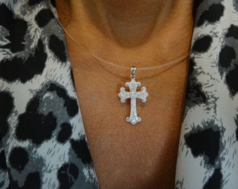 Sterling silver and cubic zirconia cross pendant.