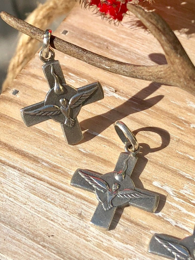 Holy Spirit Cross Sterling Silver.