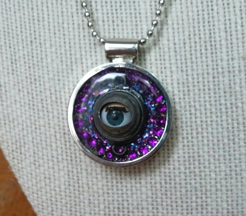 Creepy Baby Blinky Eye Pendant in pinkpurple