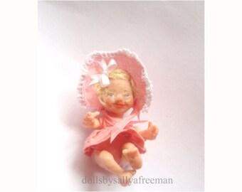 Miniature handmade dolls house baby girl