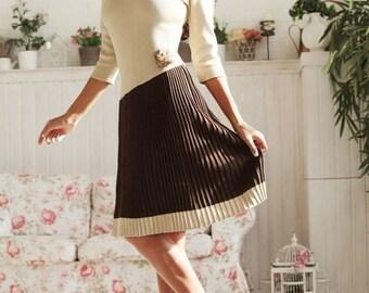 "Warm knitted dress ""Nastasia"" with a pleated skirt, asymmetrical cut"