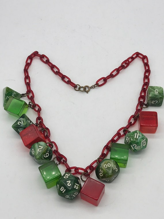 Rare Vintage Bakelite and Celluloid dice necklace.