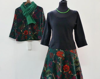 Mid-length skirt in green cotton velvet with large orange flowers