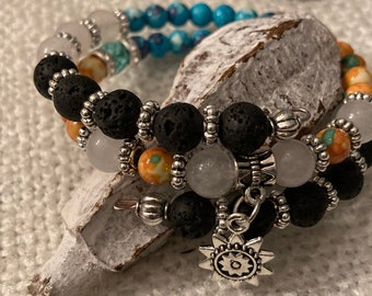 Gorgeous White Jade, Lava stone and marbled blue and orange beads with silver spacers and sun charm