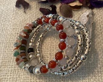 Red Jade, White Jade, Unakite, Hematite and larvikite bracelet with gemstone and pewter filigree tube beads