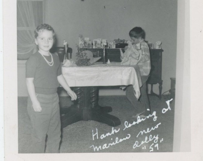 "Vintage Snapshot Photo: ""Hank looking at Marilou's new dolly, '59"" [85676]"