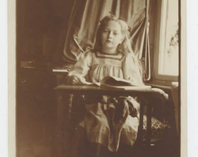 Vintage Snapshot Photo: Young Girl Reading By Window, 1909 [810734]