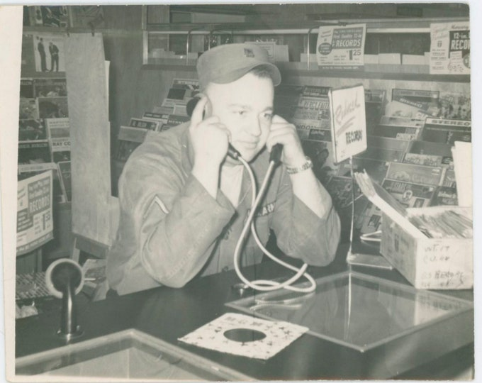 G.I. Gives 45 a Spin in Record Store, c1950s Vintage Snapshot Photo [811745]