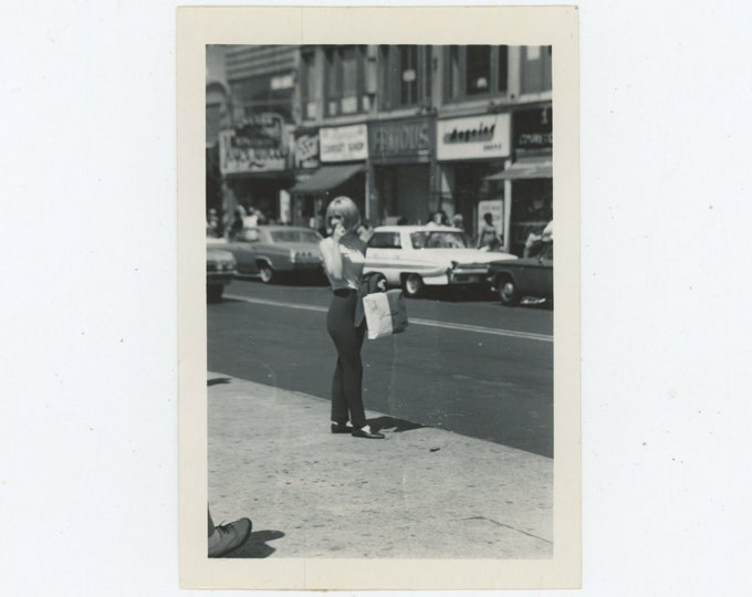 Vintage Snapshot Photo: Gal Shopping; Foot in Edge of Frame, 1960s [89727]