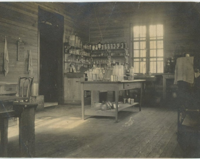 Vintage Snapshot Photo: Laboratory; Figure Hiding Behind Towel in Corner (87700)