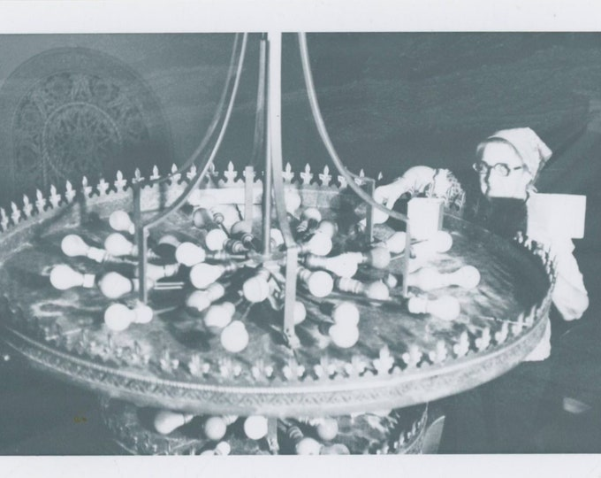 How to Change Chandelier Light Bulbs: Vintage Snapshot Photo [811746]