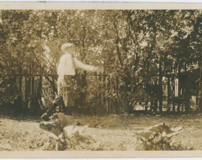 Vintage Snapshot Photo: Boy Playing Horseshoes, c1920s  [91764]
