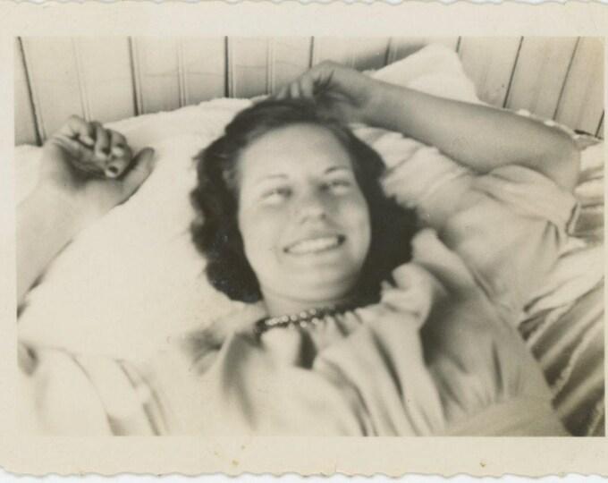 Vintage Snapshot Photo: Smiling Gal on Pillow (81636]
