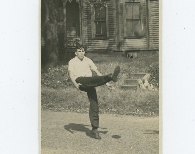 Kicking a Football: Vintage Snapshot Photo, c1940s [86695]