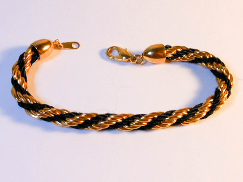 aebe3cbc61f6a Black & Gold Twisted Rope Bracelet , 7 Inch