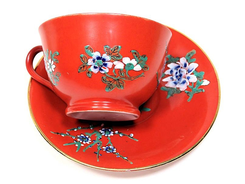 YT,Japanese,Rust,Red,Enamelled,Teacup,and,Saucer,Hong,Kong,yt_japan,hong_kong_decorated,japanese_teacup,rust_red_teacup,enamelled_teacup,enamelled_floral_cup,japanese_porcelain,enamelled_porcelain,floral_decorated_cup,red_japan_teacup,chinese_red_teacup