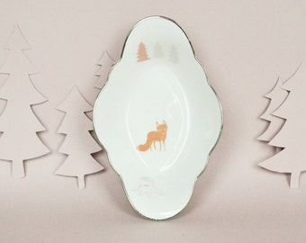 Dish with a fox and trees