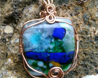 Gorgeous Copper Wire Wrapped Blue and Green glass fusion pendant.
