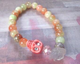 Orange Skull with Crystal Eyes Stretch Bracelet with Clear Flower