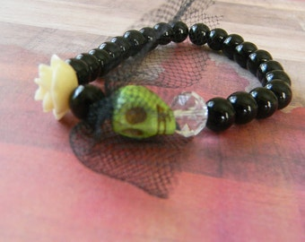 Green Skull Bride with Cream Carved Rose Beaded Stretch Bracelet and Black Beads