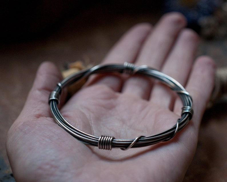 Wound and bound bangle slim gyre bangle wire wrapped image 0