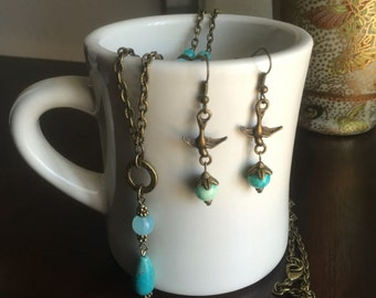 Set of 2/Blue beaded antique gold and sparrow necklace and earrings