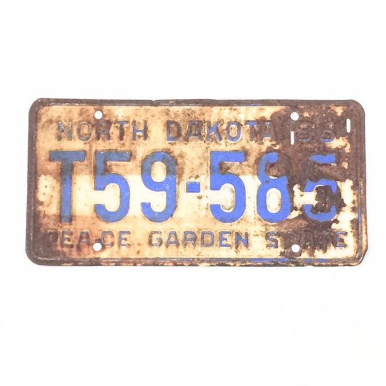 Vintage License PlateDistressed ND PlateRusty Gold image 0