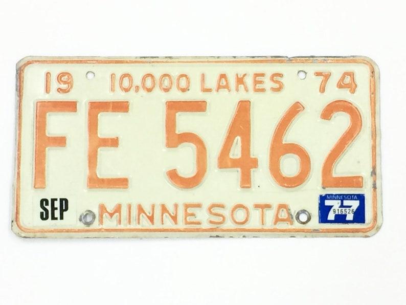 Vintage MN License PlateDistressed PlateOrange White image 0
